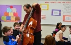 Mike Block playing cello with Academy kids